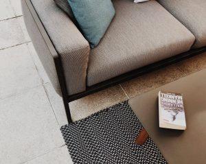 Carpet tiles underneath sofa
